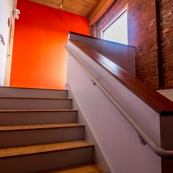 white painted stairs with a steel bar on it